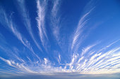 Streaks of cirrus clouds in bright sky