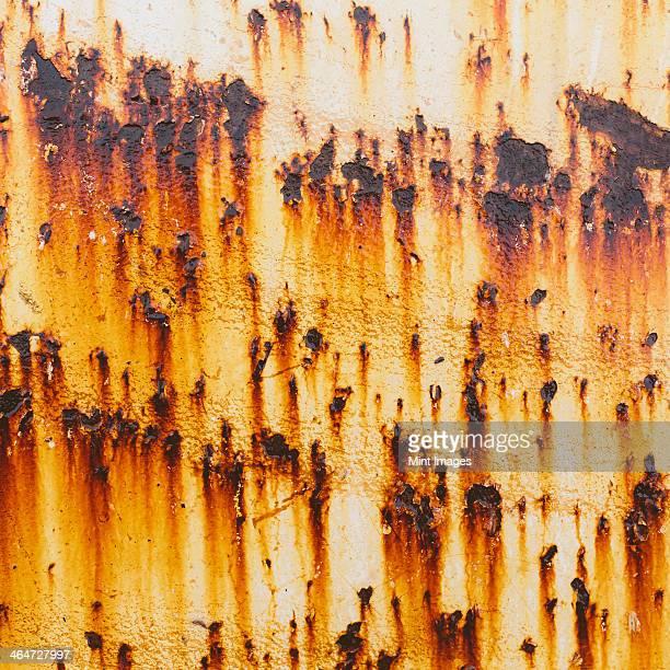 Streaks of rust from steel bolts on a metal sheet