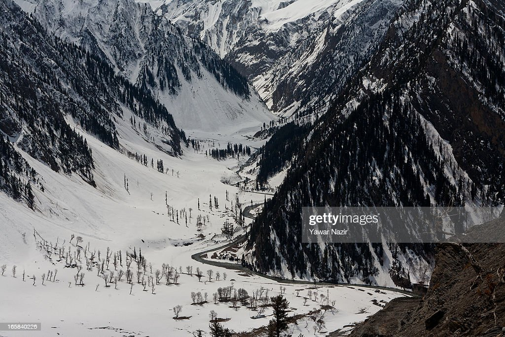 A stream flow through snow on Srinagar-Leh highway on April 06, 2013 in Zojila, 108 km (67 miles) east of Srinagar, the summer capital of Indian administered Kashmir, India. The 443 km (275 miles) long Srinagar-Leh highway was opened for vehicular traffic by Indian Border Roads Organisation after remaining snowbound at Zojila Pass for the past six months. The pass connects Kashmir with Ladakh region a famous tourist destination among foreign tourists for its monasteries, landscapes and mountains.