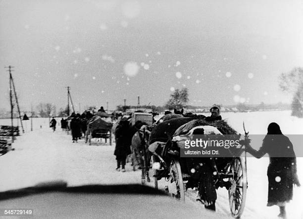 Stream of refugees from the eastern parts of Germany on a snowy country road in Lusatia February 1945