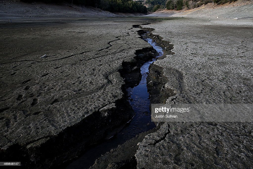 A stream of water cuts through the dry bottom of the Almaden Reservoir on January 28 2014 in San Jose California Now in its third straight year of...