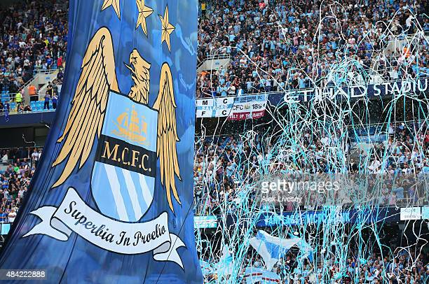 Streamers are thrown by Manchester City fans during the Barclays Premier League match between Manchester City and Chelsea at the Etihad Stadium on...