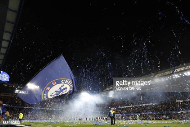 Streamers errupt over the pitch at the end of the English Premier League football match between Chelsea and Watford at Stamford Bridge in London on...