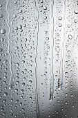 Streaming condensation on grey