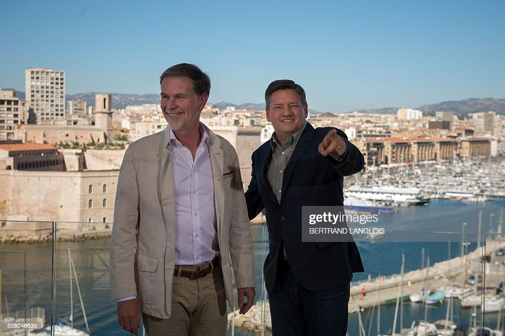 US streaming video giant Netflix co-founder and CEO Reed Hastings (L) and Netflix Chief content officer Ted Sarandos pose during a photocall for the premiere of the French TV show 'Marseille' broadcasted and co-produced by Netflix on May 4, 2016 in Marseille, southern France. / AFP / BERTRAND