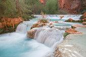 Streaming water at the bottom of Havasu Falls, Arizona, USA