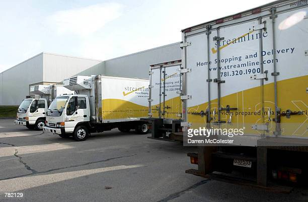 Streamlinecom delivery trucks are parked at the distribution center November 16 2000 in Westwood MA The web grocer which services customers in...