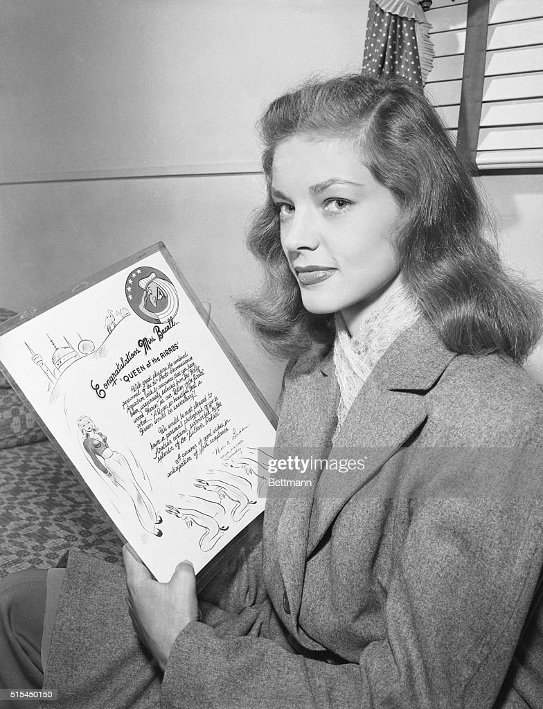 11/1/1944- Streamlined Lauren Bacall speeds to stardom in her screen debut as Humphrey Bogart's love interest in Warner Bros. 'To Have and to Have Not.' From New York fashion model to Bogey's belle is quite a trip but Bacall made it and in record time, too. Photo shows Miss Bacall holding a plaque in honor of her good looks.