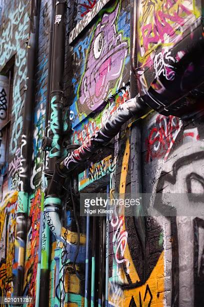 Street Art and Graffiti in Hosier Lane Melbourne Australia Hosier Lane as a small lane in Melbourne city reserved for Graffiti artists to decorate