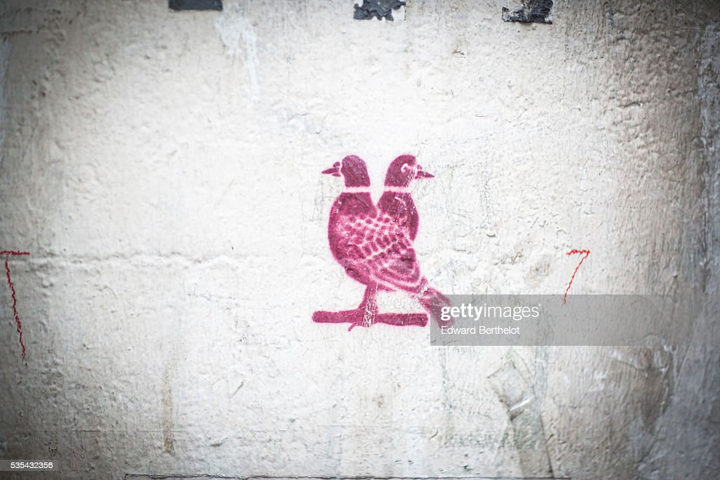 Street art graffiti are seen, in the 13th quarter of Paris, on May 29, 2016 in Paris.