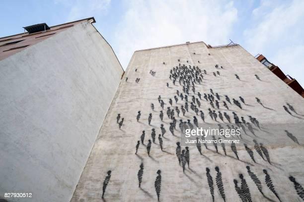 Street art graffiti are seen representing people by Suso33 in the Madrid neighborhood of Estrecho on August 07 2017 in Madrid Spain