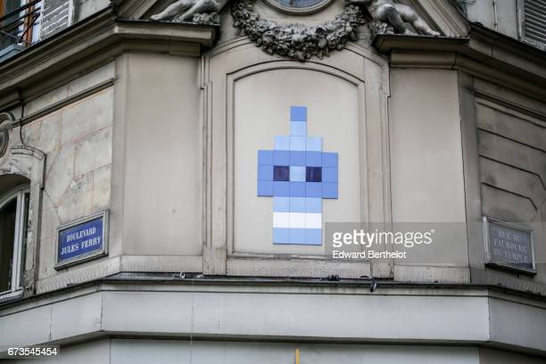 Street art graffiti showing a blue character made of tiles is seen between Boulevard Jules Ferry and Rue du Faubourg du Temple on April 16 2017 in...