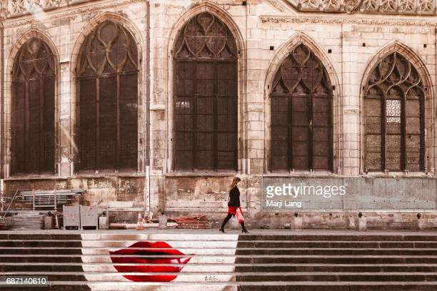 Street art painting by the north facade of the SaintMerri church in Paris France
