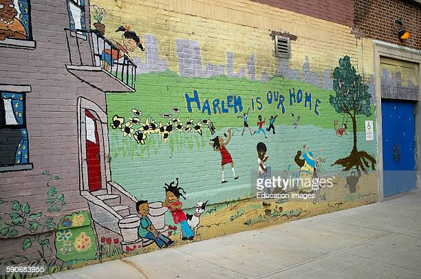 Street art painting Harlem is our Home painted on a school wall in Harlem New York USA