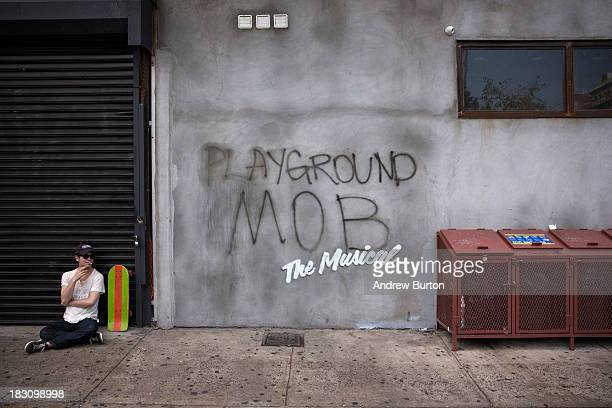 Street art reading 'Playground Mob The Musical' allegedly done by the British street artist Banksy is seen in the Lower East Side on October 4 2013...