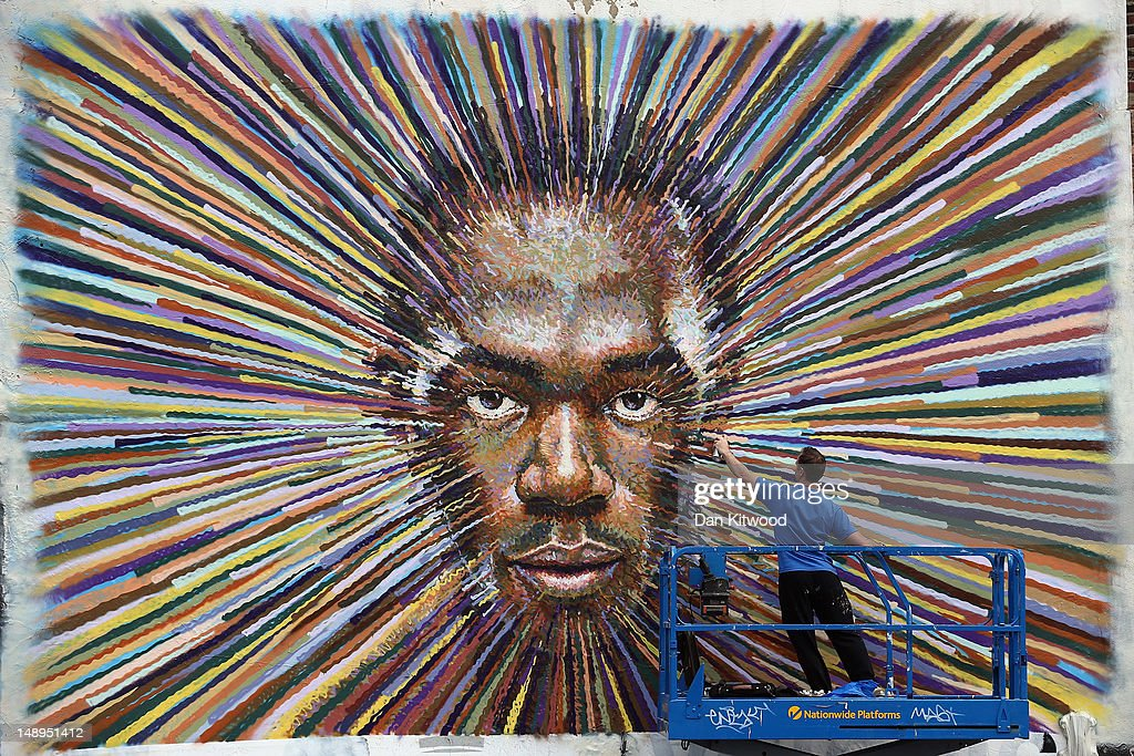 Street artist James Cochran, Aka Jimmy C puts the finishing touches to a piece of work depicting the face of Jamaican sprinter <a gi-track='captionPersonalityLinkClicked' href=/galleries/search?phrase=Usain+Bolt&family=editorial&specificpeople=604196 ng-click='$event.stopPropagation()'>Usain Bolt</a> on July 20, 2012 in London, England. The opening ceremony of the 2012 Olympic games will take place in seven days on July 27, 2012.