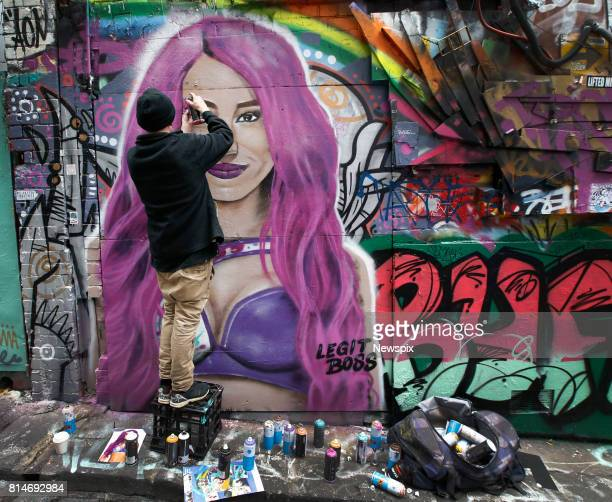 MELBOURNE VIC Street artist Maha finishes the portrait of WWE star Sasha Banks in Hosier Lane in Melbourne Victoria