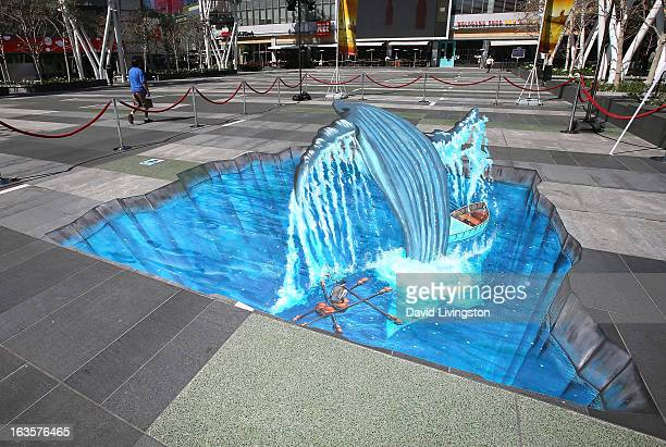 Street artist Tracy Lee Stum's recreation of an iconic scene from 'Life of Pi' in 3D chalk art is seen at LA LIVE on March 12 2013 in Los Angeles...