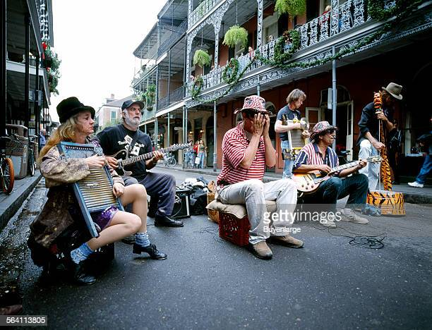 A street band has no competition from other musicians or automobiles on Bourbon Street in the French Quarter of New Orleans Louisiana