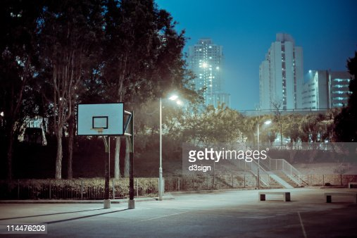 Street basketball court at night
