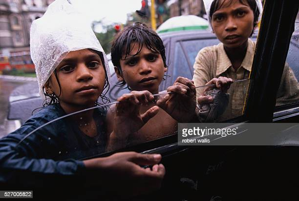 Street beggars in Bombay Many beg for themselves while others are controlled by bosses who take what the kids collect in return for food and shelter...