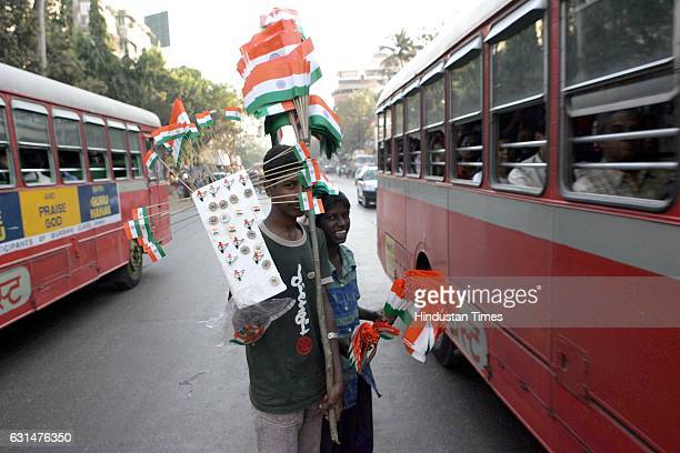 Street Boys selling the Flag during the eve of Republic Day at Santacruz on Wednesday