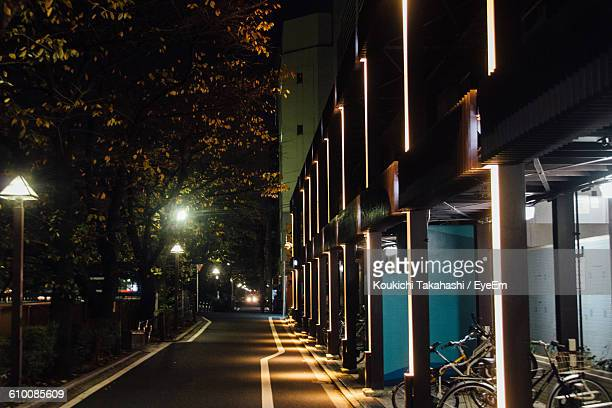 Street By Buildings At Night