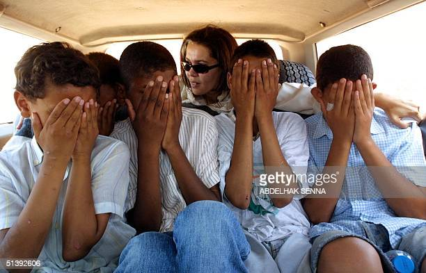 Street children alleged victims of pedophilia accompanied by Touria Bouabid the president of the MESIP are driven from the courthouse 23 July 2001 in...