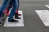 In the street, children crossing a crosswalk
