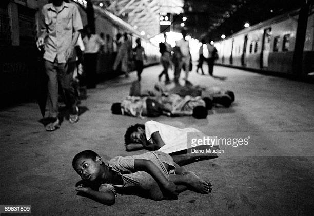 Street children from the Victoria Terminus gang waking up on platform 7 at Victoria Terminus station in Bombay