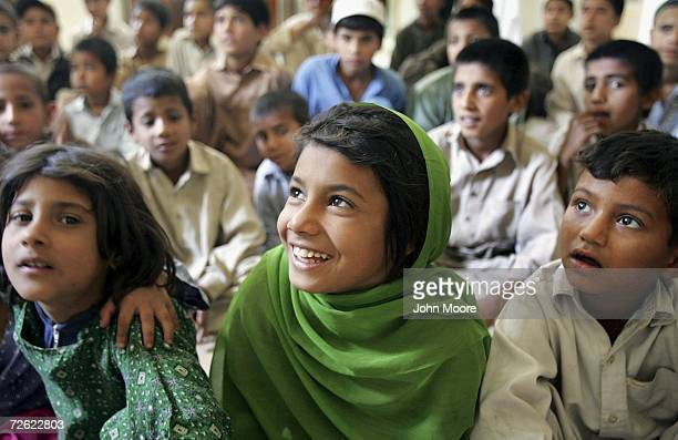 Street children listen during an AIDS awareness class on April 21 2006 at a daytime shelter in Peshawar Pakistan Street children often exploited for...