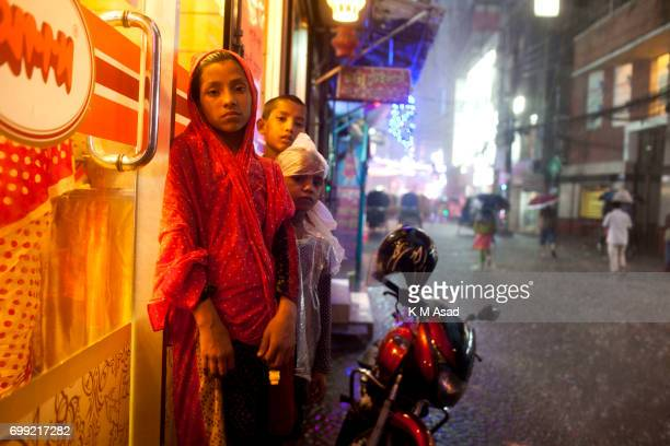 OLD DHAKA DHAKA BANGLADESH Street children take shelter in a street shop when heavy rainfall made in Dhaka city The death toll rises to 150 in...