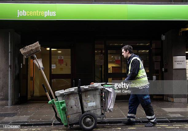 A street cleaner passes the Jobcentre Plus office on January 18 2012 in Bath England Figures released today show that the UK unemployment rate has...