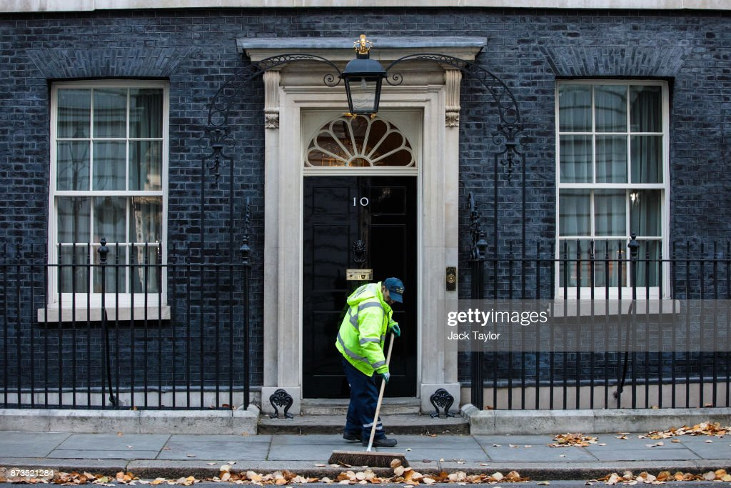 A street cleaner sweeps leaves outside Number 10 Downing Street on November 13, 2017 in London, England. British Prime Minister Theresa May is to hold a meeting with European business leaders today over their concerns about the future of UK-EU trade arrangements after Brexit.