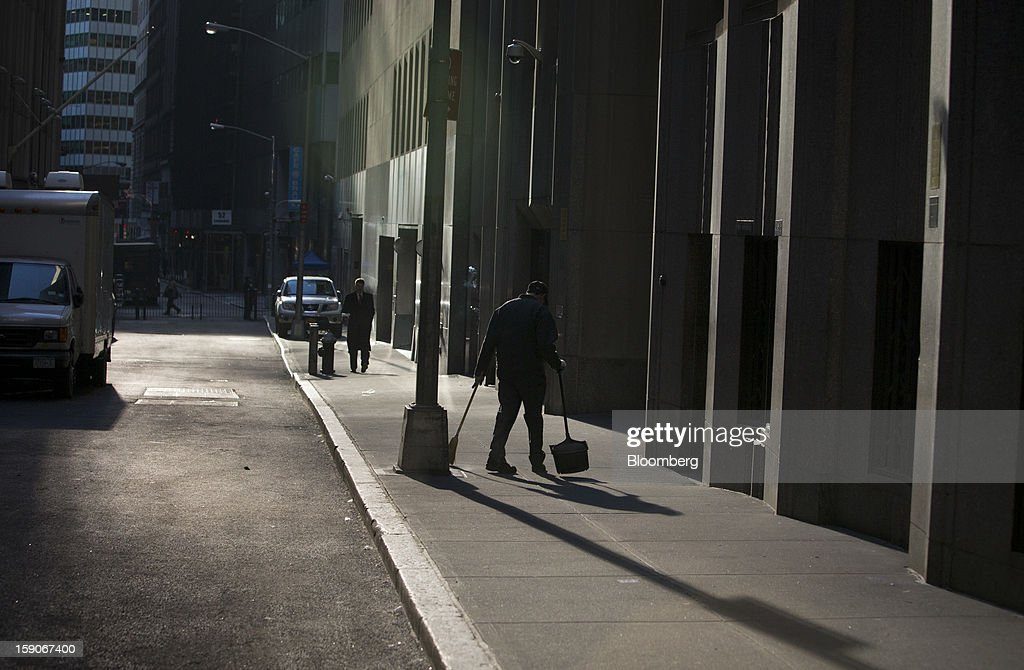 A street cleaner sweeps outside of the New York Stock Exchange (NYSE) in New York, U.S., on Monday, Jan. 7, 2013. U.S. stocks fell, after the Standard & Poor's 500 Index climbed to a five-year high, as investors awaited the start of the corporate earnings season tomorrow. Photographer: Scott Eells/Bloomberg via Getty Images