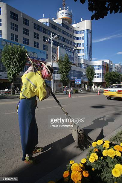 A street cleaner sweeps the streets clean in the new part of Lhasa city on August 5 2006 in Lhasa of Tibet Autonomous Region China Lhasa's face is...