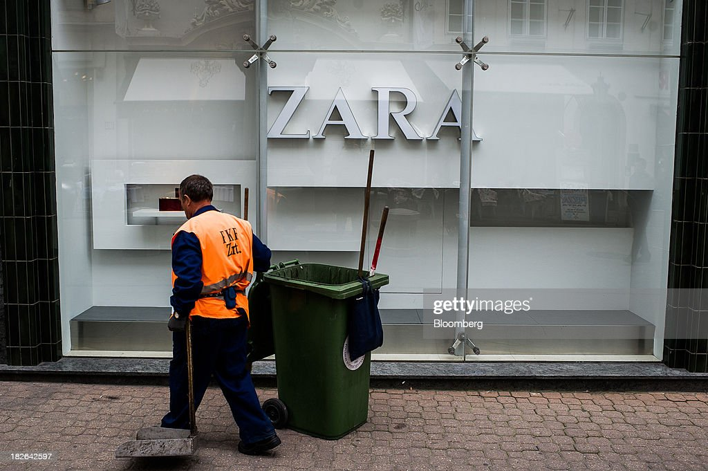 A street cleaner works outside the empty window of a Zara fashion store, operated by Inditex SA, in Budapest, Hungary, on Wednesday, Oct. 2, 2013. 'The retail sales environment in Europe, especially in Spain, has become less challenging in the last few weeks, while the weather overall has also been more stable,' Anne Critchlow, a London-based analyst at Societe Generale, said. Photographer: Akos Stiller/Bloomberg via Getty Images