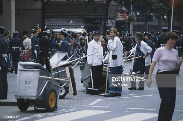 Street cleaners outside Aldwych station on the procession route for Prince Charles and Princess Diana on their wedding day London 29th July 1981
