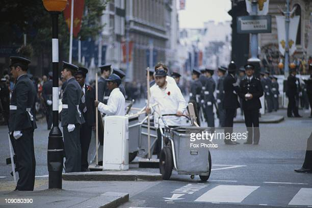 Street cleaners police officers and RAF along the procession route for Prince Charles and Princess Diana on their wedding day London 29th July 1981