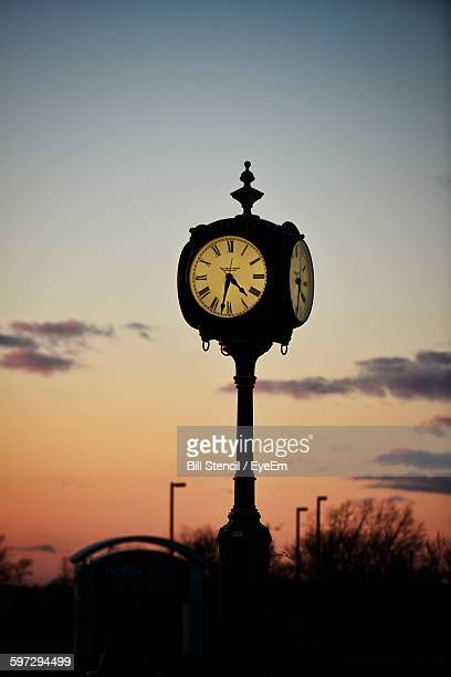 Street Clock Against Sky At Sunset