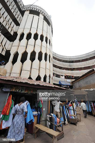 Street clothes vendors are pictured on March 16 2009 at the Yaounde main market AFP PHOTO / ISSOUF SANOGO