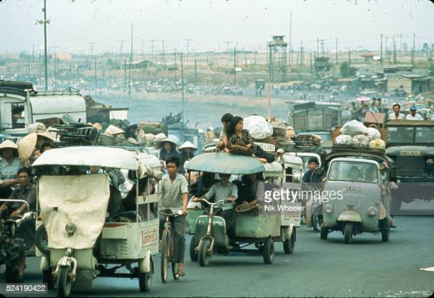 A street congested with traffic as refugees flee in automobiles to Saigon near the end of the Vietnam War South Vietnam