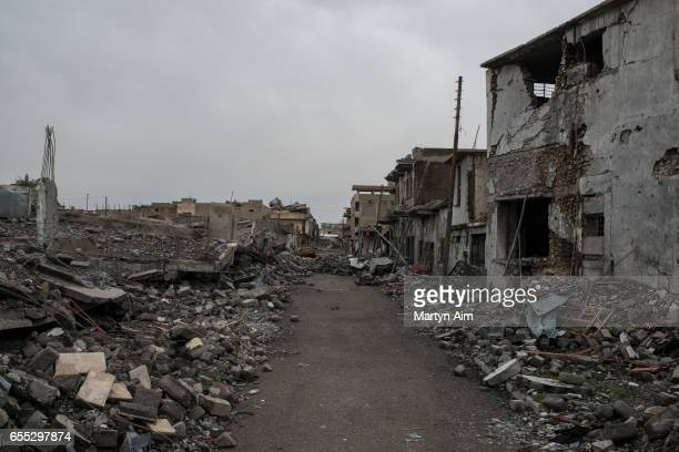 A street damaged by an airstrike in the fight between Iraqi forces and Islamic State on the frontline in alDowasa west Mosul March 18 2017 Iraqi...