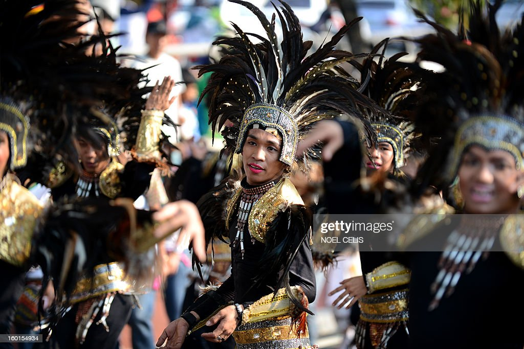 A street dancer performs during the annual Grand Santo Nino Procession in Manila on January 27, 2013. The annual Grand Santo Nino Procession features almost 300 floats with different images of the child Jesus Christ flown in from various parts of the country. The Philippines is Asia's bastion of Catholicism and the Sto Nino feast is one among dozens of religious festivals honouring various saints and religious icons, a legacy of three centuries of Spanish rule across the archipelago. AFP PHOTO/NOEL CELIS