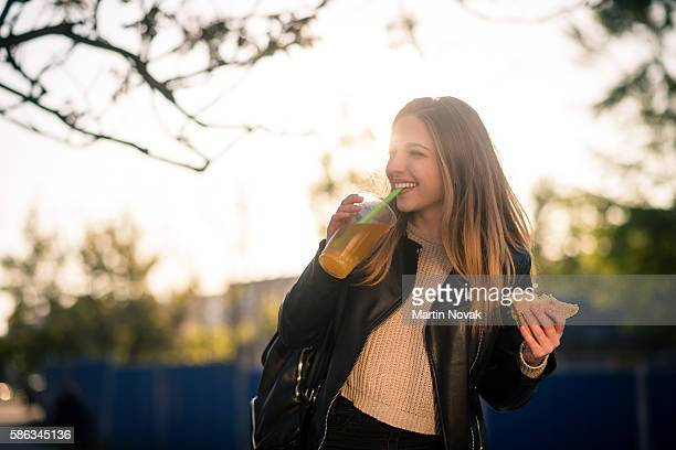 Street dinner - teen with sandwich and juice