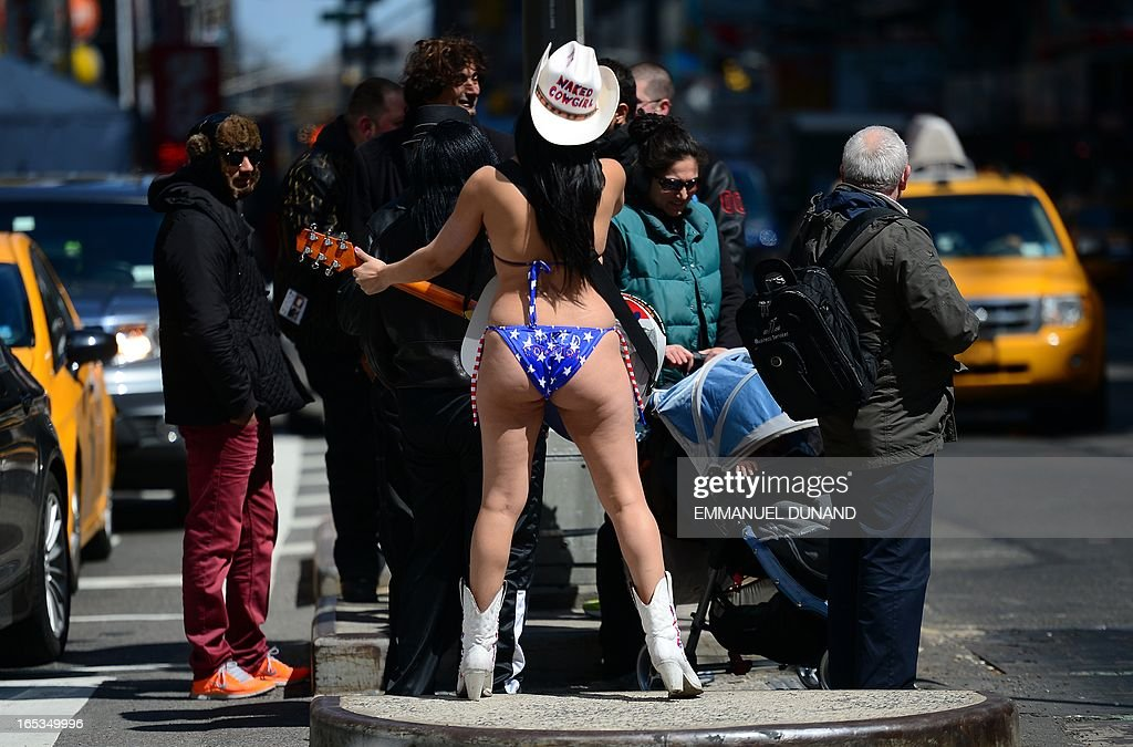 Street entertainer the 'Naked Cowgirl' performs on Times Square in New York, April 3, 2013. AFP PHOTO/Emmanuel Dunand