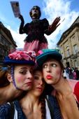 Street entertainers perform on Edinburgh's Royal Mile during the city's Festival Fringe on August 7 2013 in Edinburgh Scotland The city is in full...