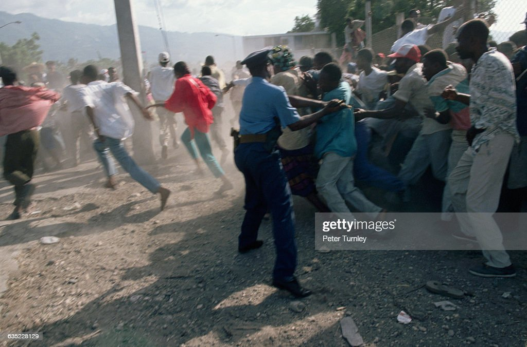 Street fights broke out between Haitian police and supporters of exiled President JeanBertrand Aristide