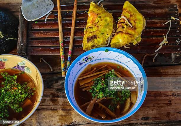 Street food Banh Xeo rice pancake with fish sauce