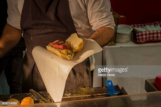 street food garnishing  a sausage sandwich